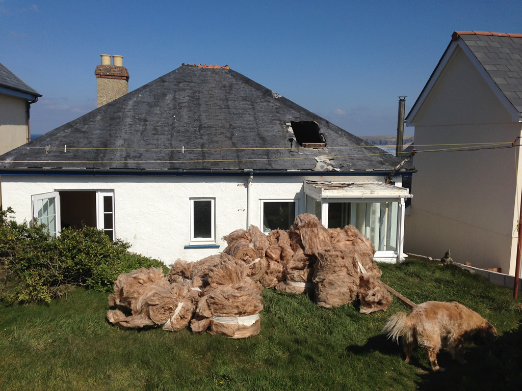 Extracting the loft insulation for re-distribution