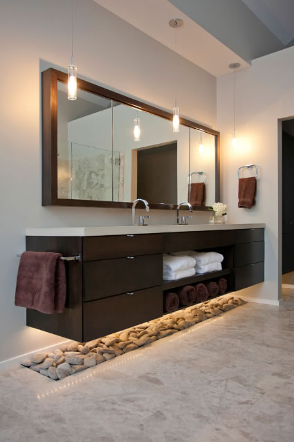 bathroom sink unit down lighting - skip the stones that will be hard to clean and a dust trap